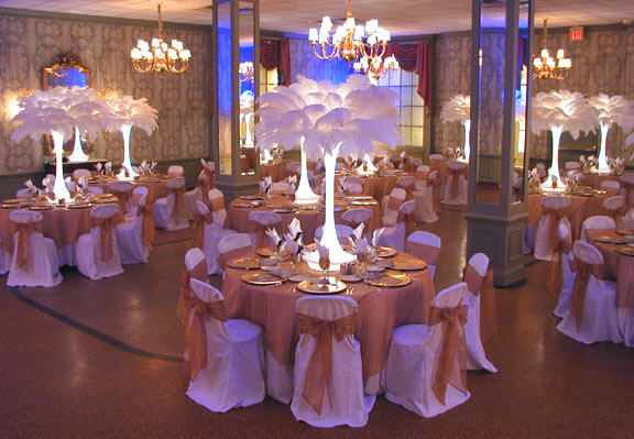 gold and white wedding decorations. Wedding Decoration Short: Ostrich centerpiece. Extended: The entire layout